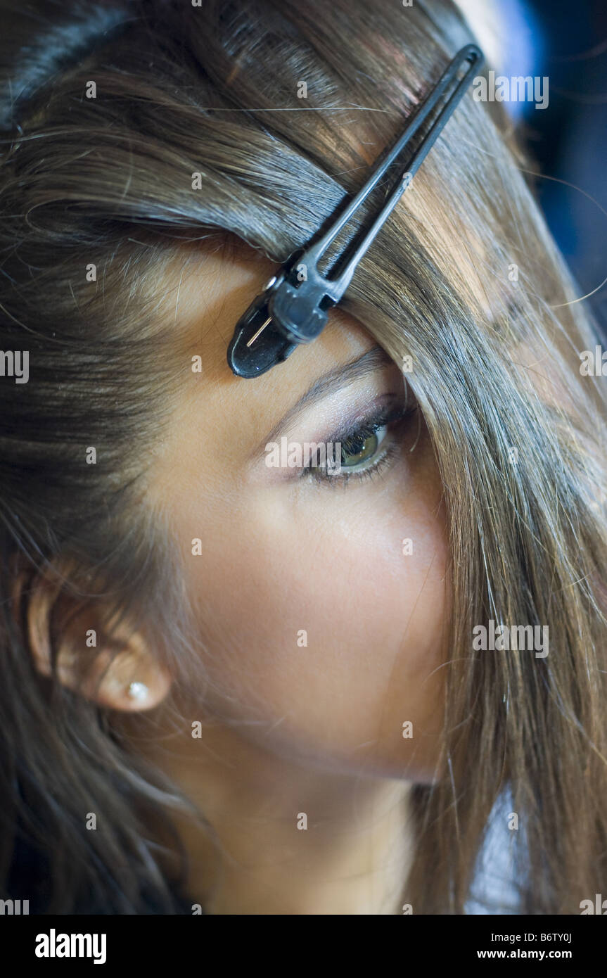 Woman getting her hair done. - Stock Image