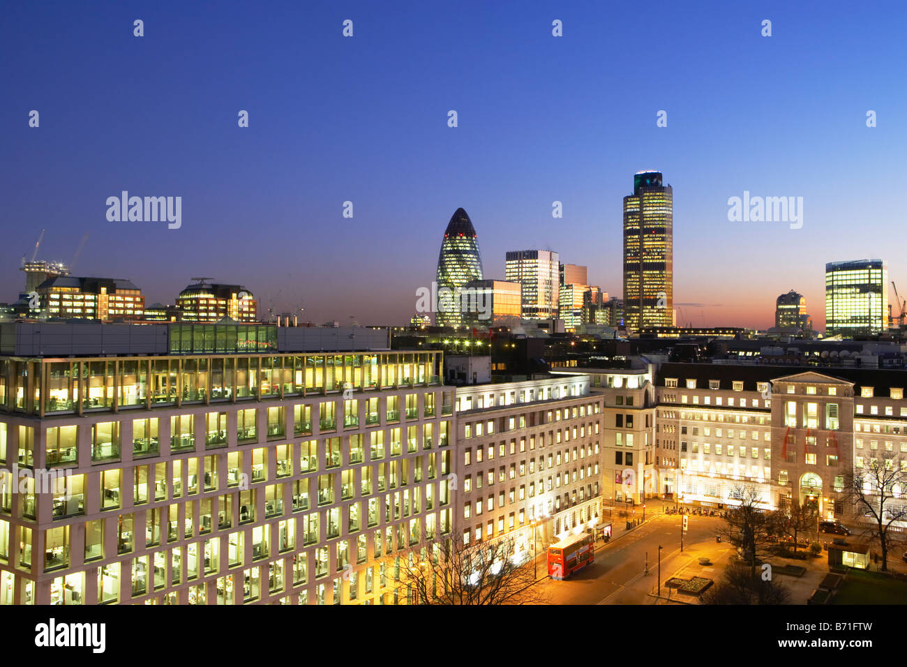 Night shot of Nat West Tower Gherkin and London skyline London England - Stock Image