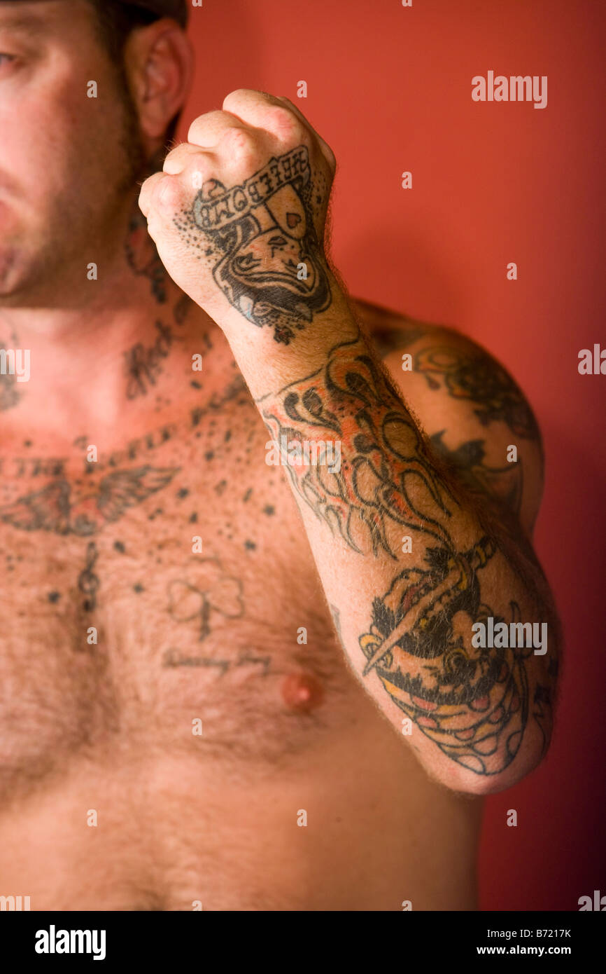 Side view of a young man with tattoo design on arm and chest Stock ... cd2c6e31f085