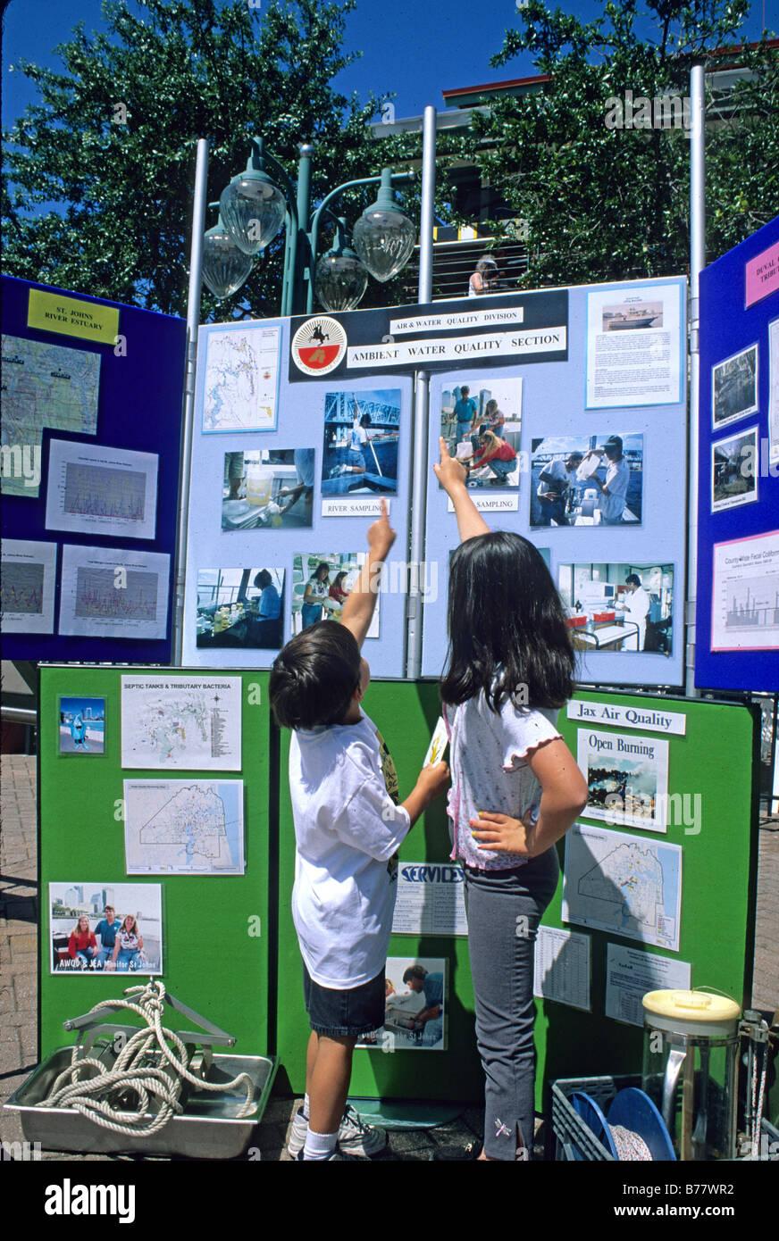 Children at exhibit Earth Day Celebration Jacksonville Florida - Stock Image