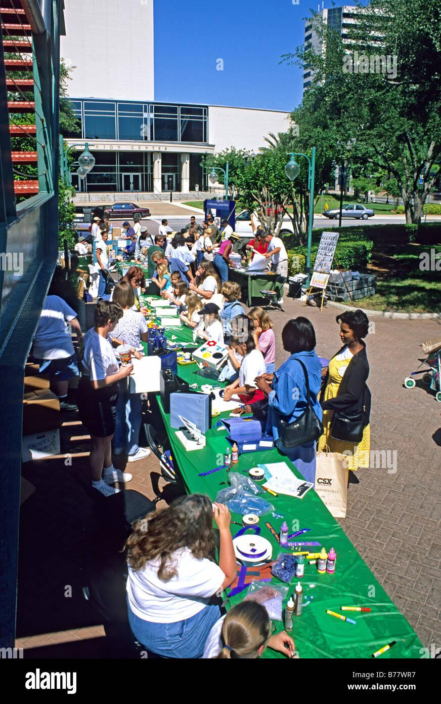 Mixed ethnic people Earth Day Celebration Jacksonville Florida - Stock Image