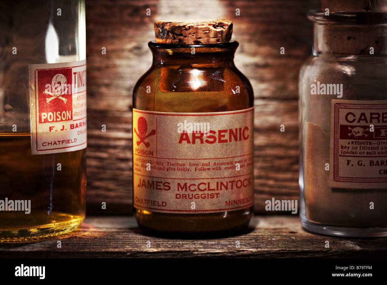 Vintage arsenic poison bottle on antique shelf Stock Photo