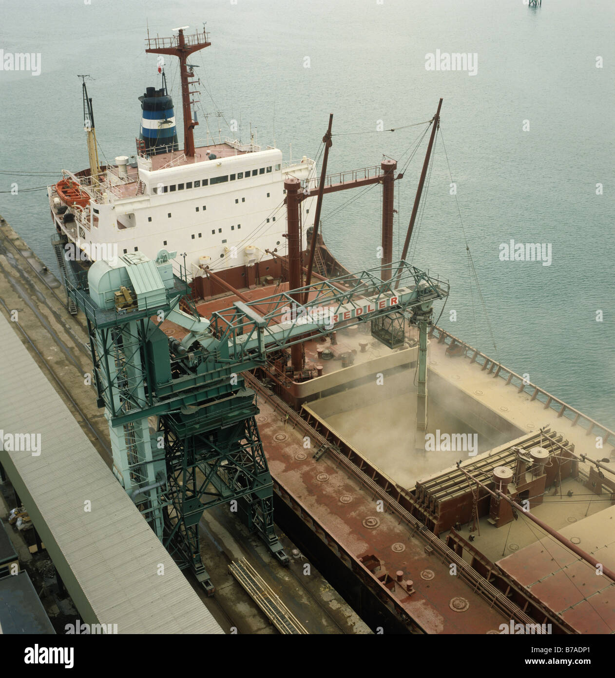 Looking down on a 26000 ton Lebanese grain ship loading its cargo at Southampton Docks - Stock Image