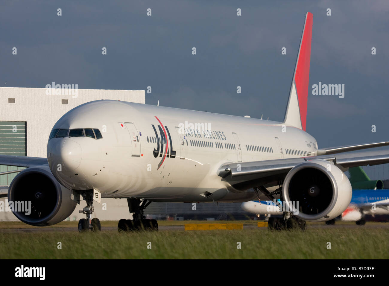 Japan Airlines - JAL Boeing 777-346/ER taxiing for departure at London Heathrow airport. - Stock Image