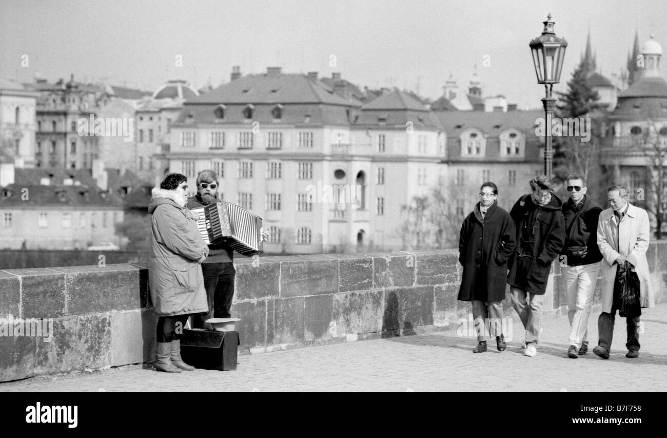 prague-czech-republic-blind-accordionist-and-singer-busking-on-charles-B7F758.jpg
