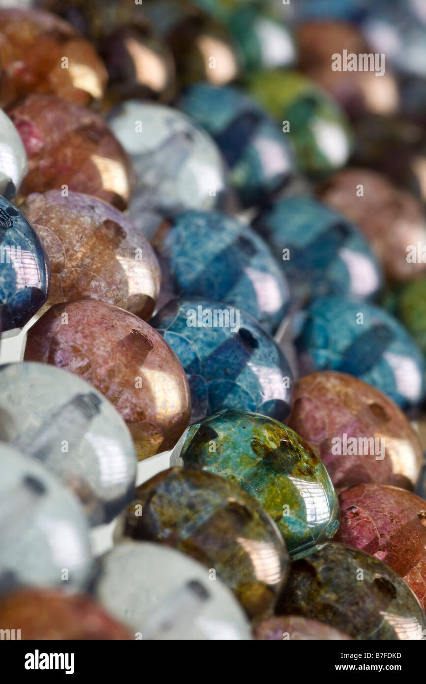 multicolored round beads in background pattern - Stock Image