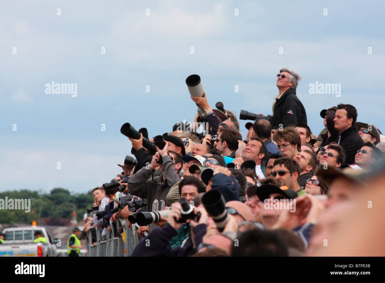 Plane spotters and photographers watching an air display of Farnborough International Airshow 2008, England, United - Stock Image