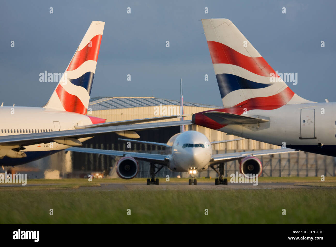 Tails of British Airways planes at London Heathrow airport. - Stock Image