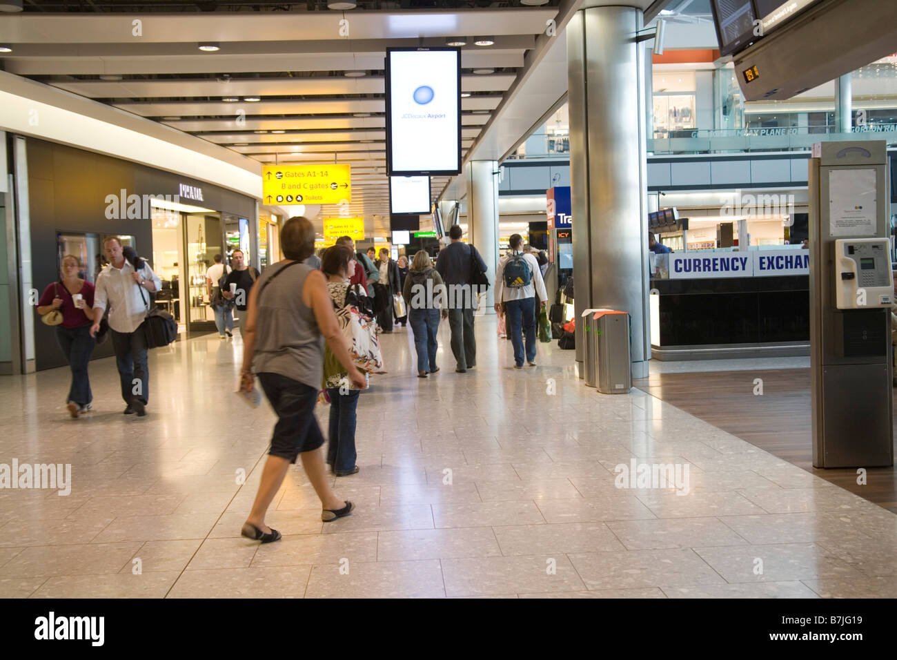 Heathrow Airport London England UK September Passengers hurrying to their gates in the Departure Lounge of Terminal - Stock Image