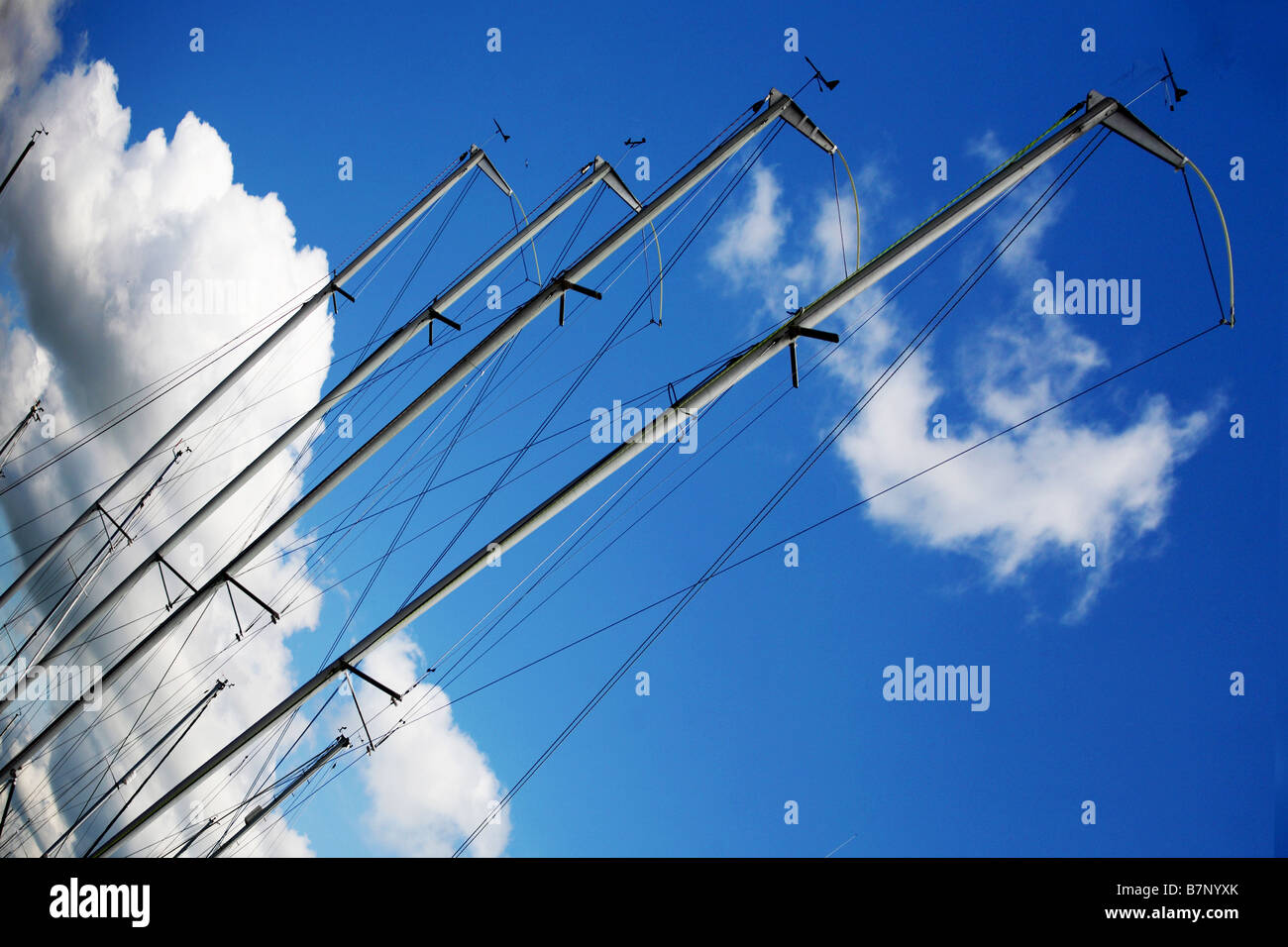 Abstract view of sailing masts against a blue sky - Stock Image