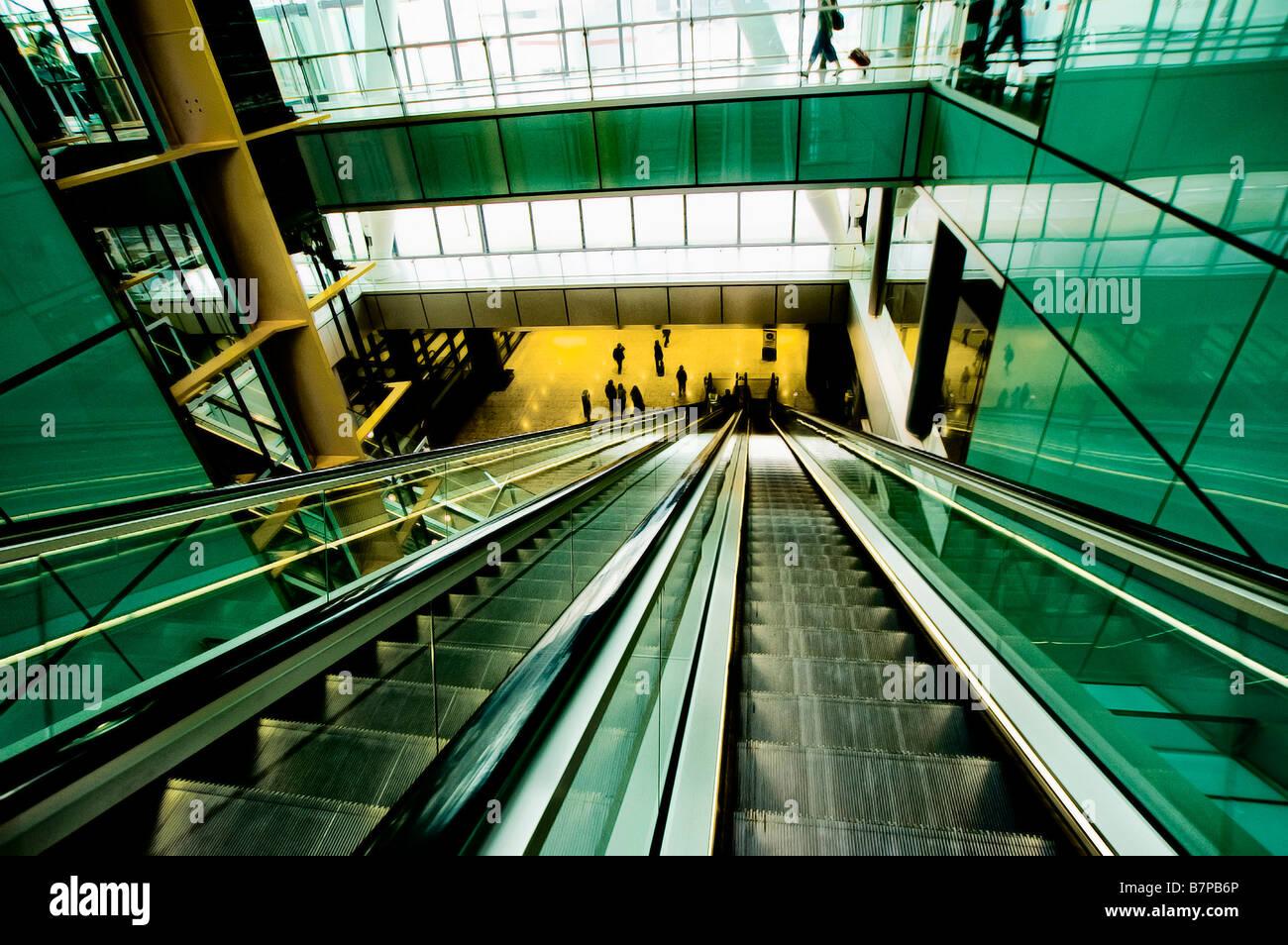 Escalators in the new Terminal 5 at Heathrow. - Stock Image