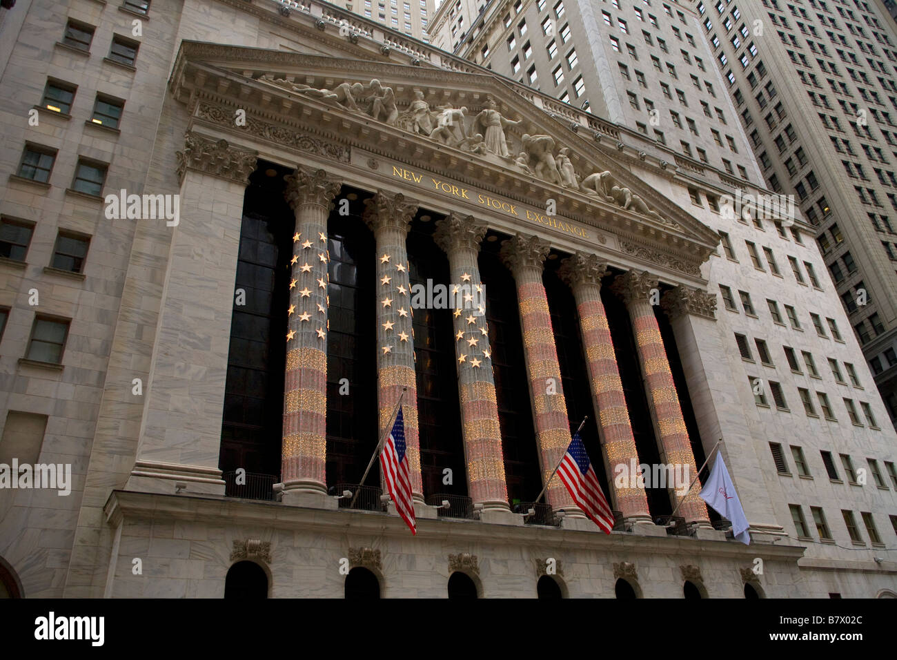 New York Stock Exchange strung with red white and blue lights creating an American Flag - Stock Image