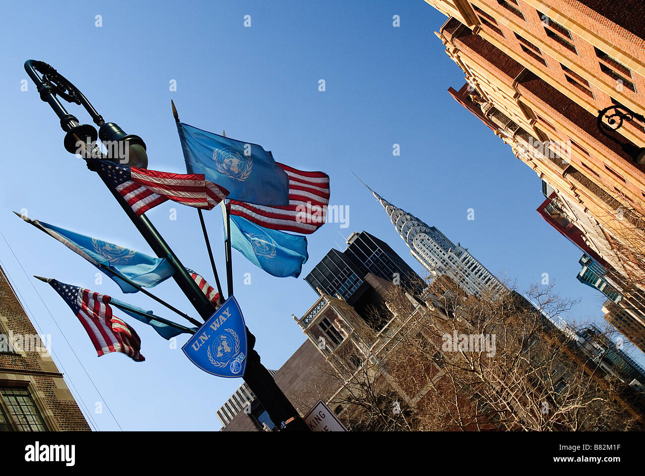American And Un Flags Flying On Un Way Near The Chrysler Building In New York City