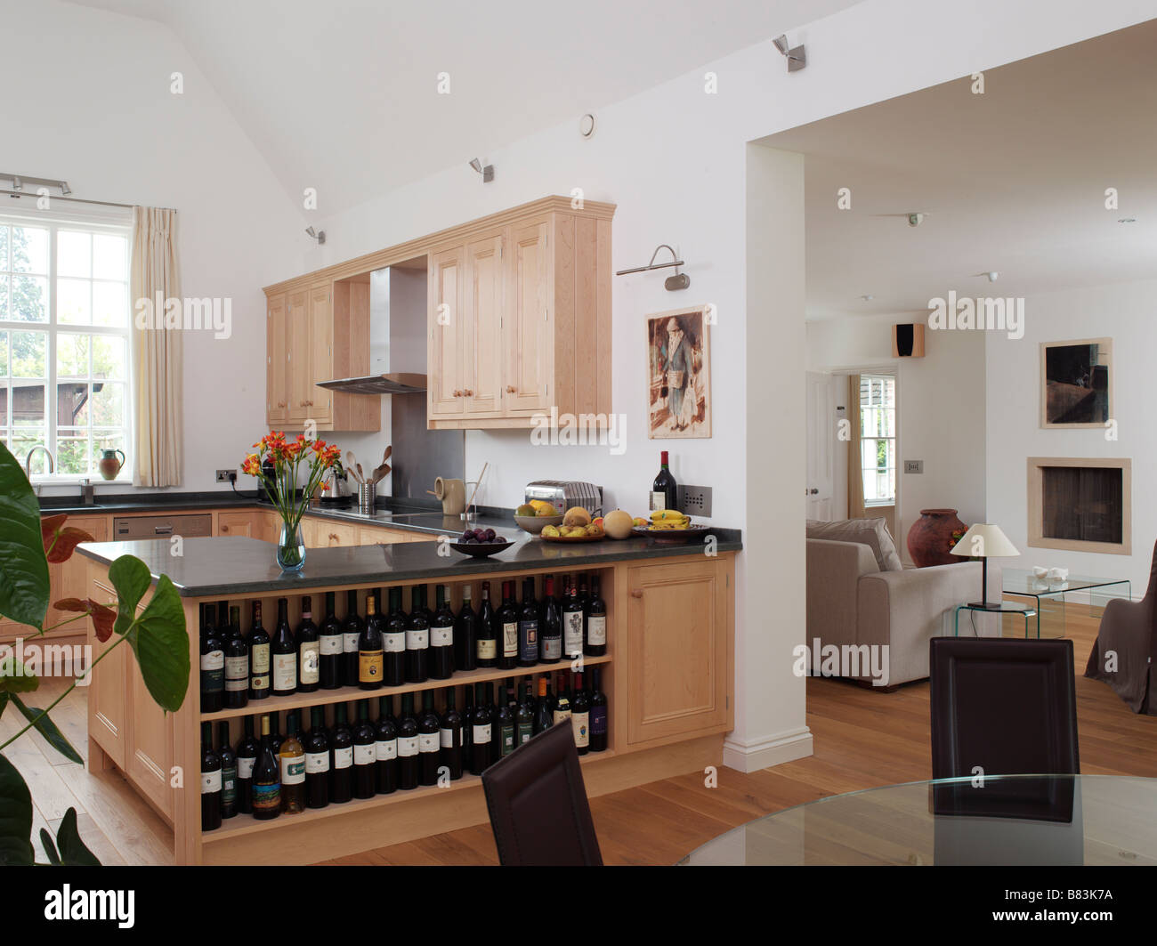 Open plan kitchen and dining room with wine shelves and view through open plan kitchen and dining room with wine shelves and view through to living room dzzzfo
