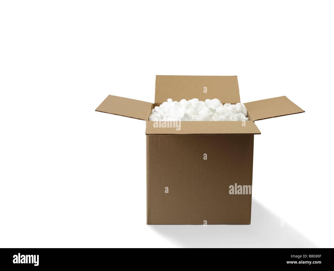 Open Cardboard Shipping Box with Styrofoam peanuts - Stock Image