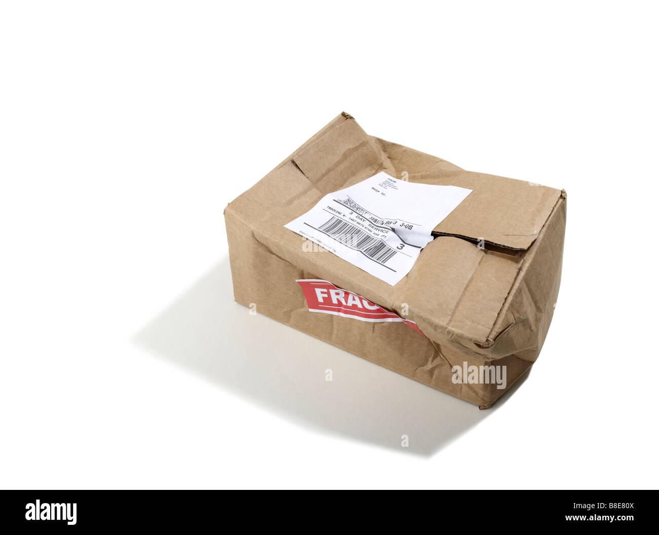 Beat up Cardboard shipping Box - Stock Image