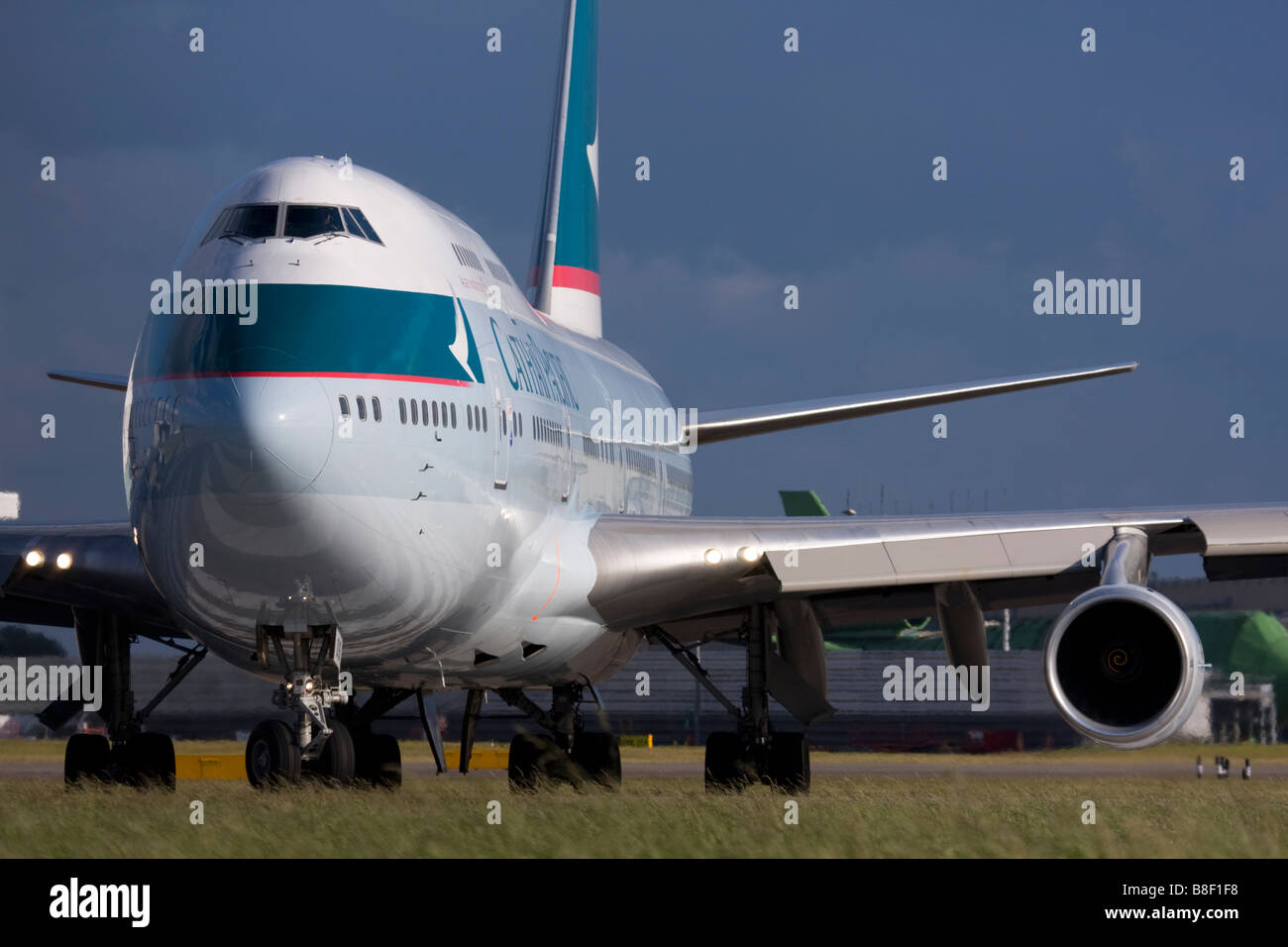 Cathay Pacific Airways Boeing 747-467 taxiing for departure at London Heathrow airport UK - Stock Image