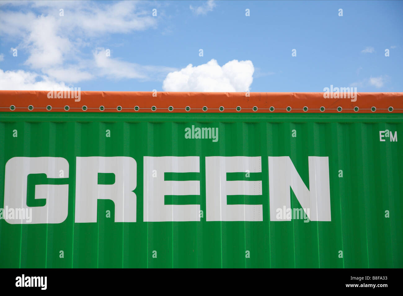 Single word green on a green shipping container - Stock Image