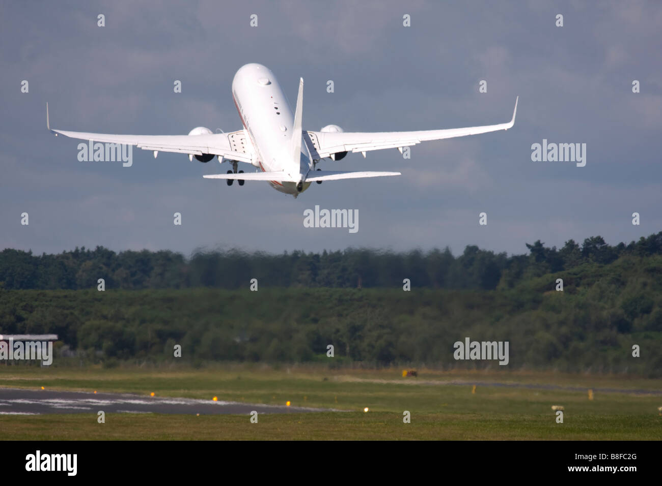 Business jet taking off Stock Photo