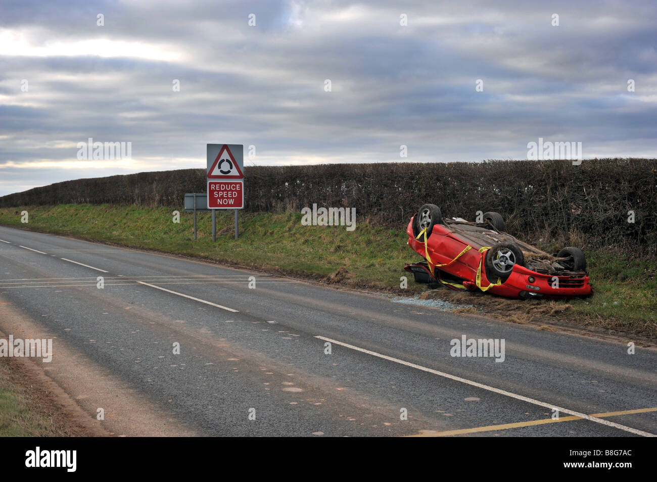 Car Crash Car Wreck Of Sports Car With Reduce Speed Sign In Stock
