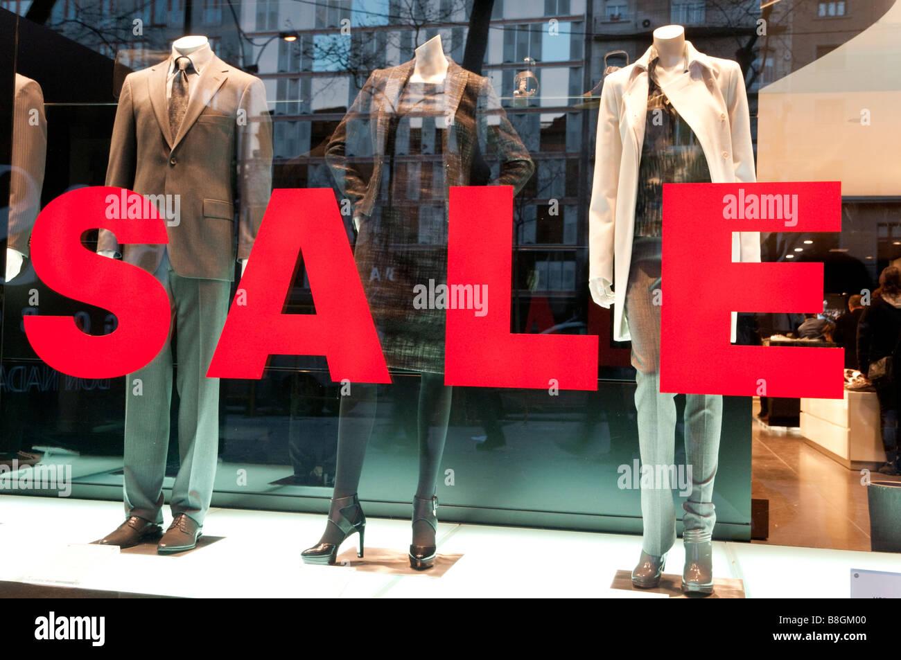 Big sales sign in shop window, Spain - Stock Image
