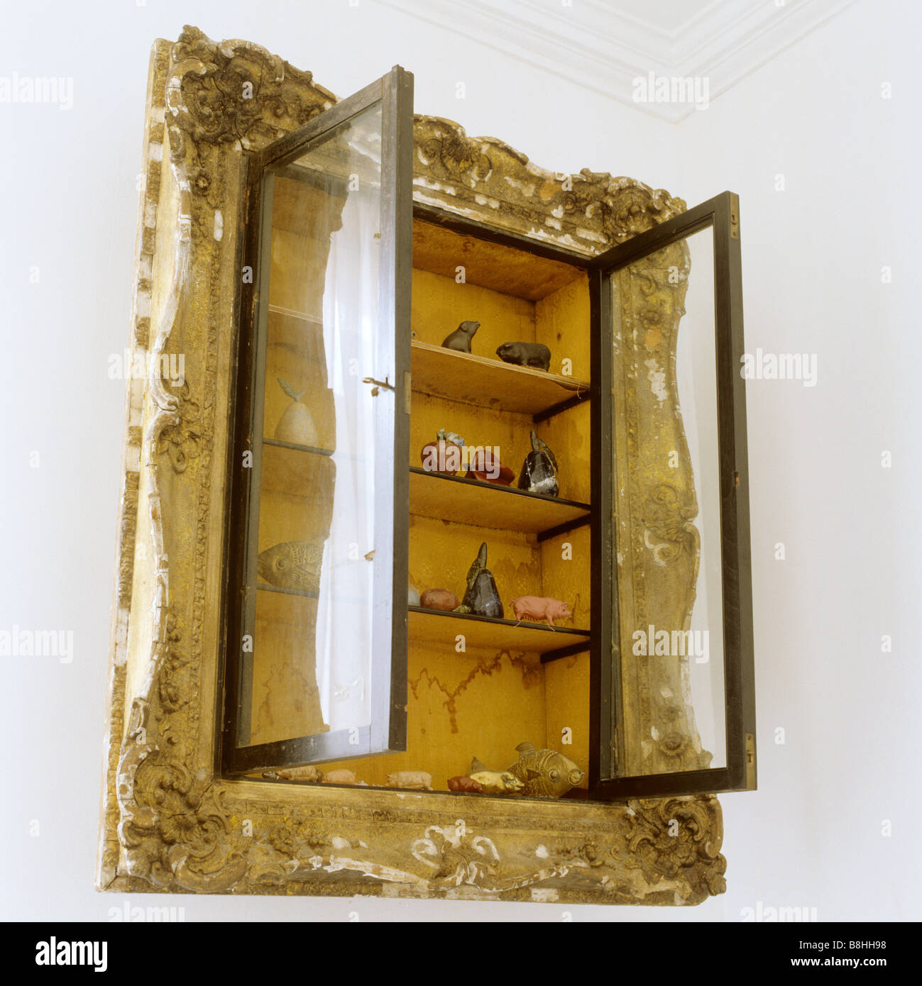 Recessed wall cabinet with an old picture frame around it - Stock Image