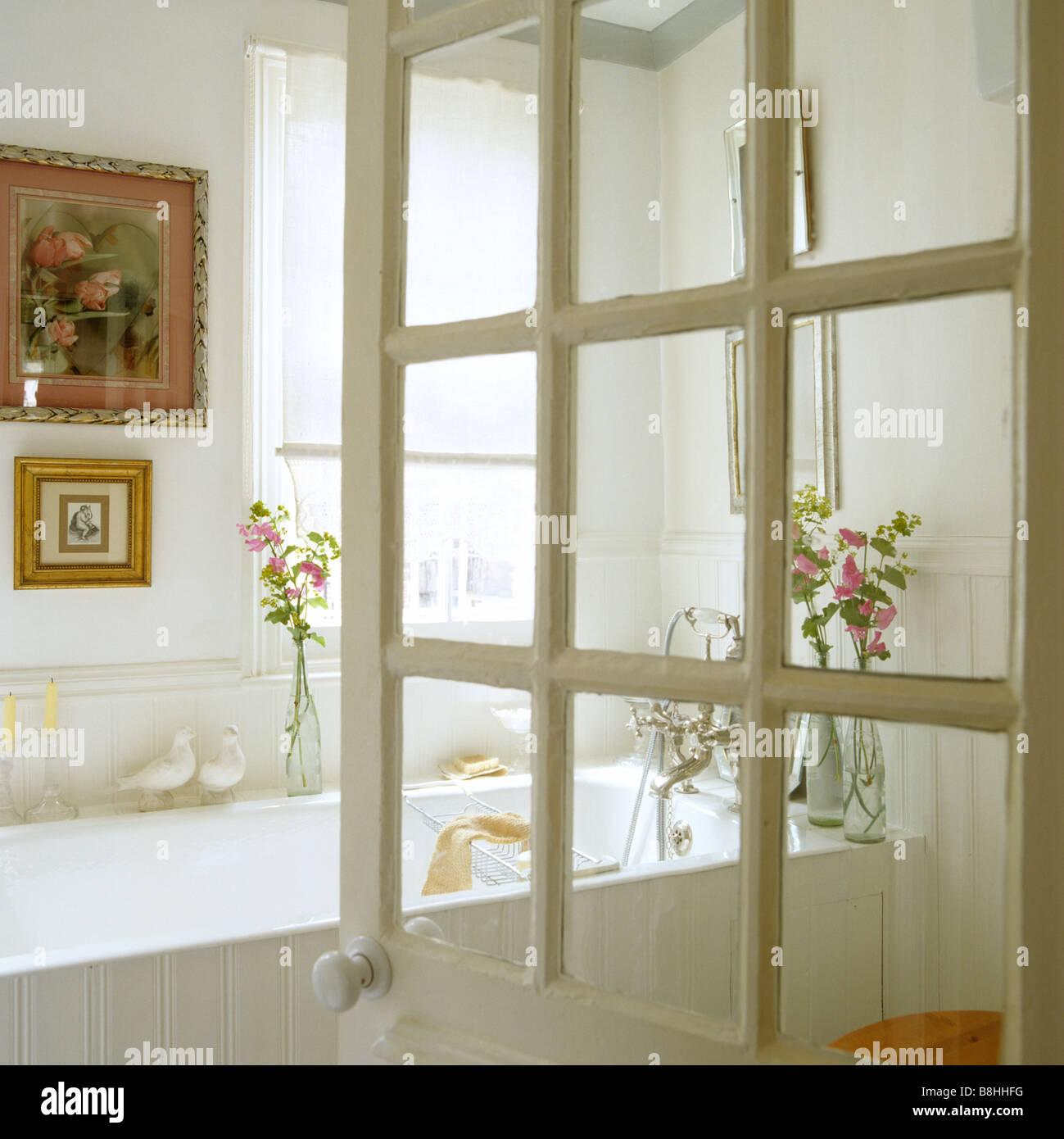 View Through Georgian Glazed Door Into A White Bathroom Stock Photo