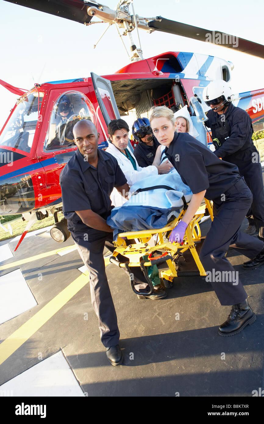 Paramedics unloading patient from Medevac - Stock Image