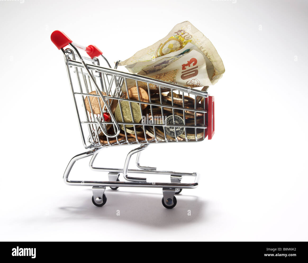 cash in a miniature shopping trolley Stock Photo