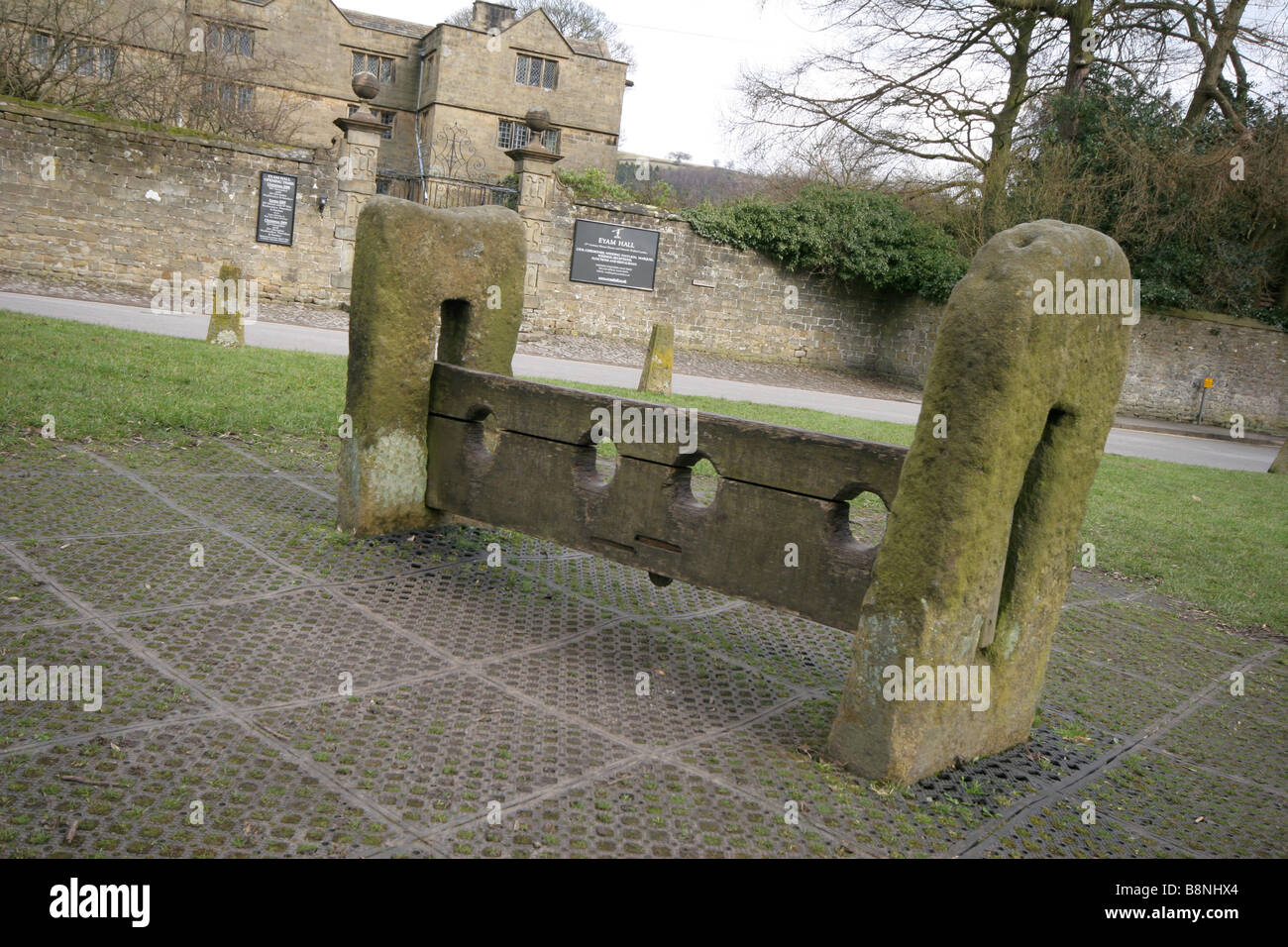 Village stocks in Eyam the Black Death plague village in Derbyshire - Stock Image