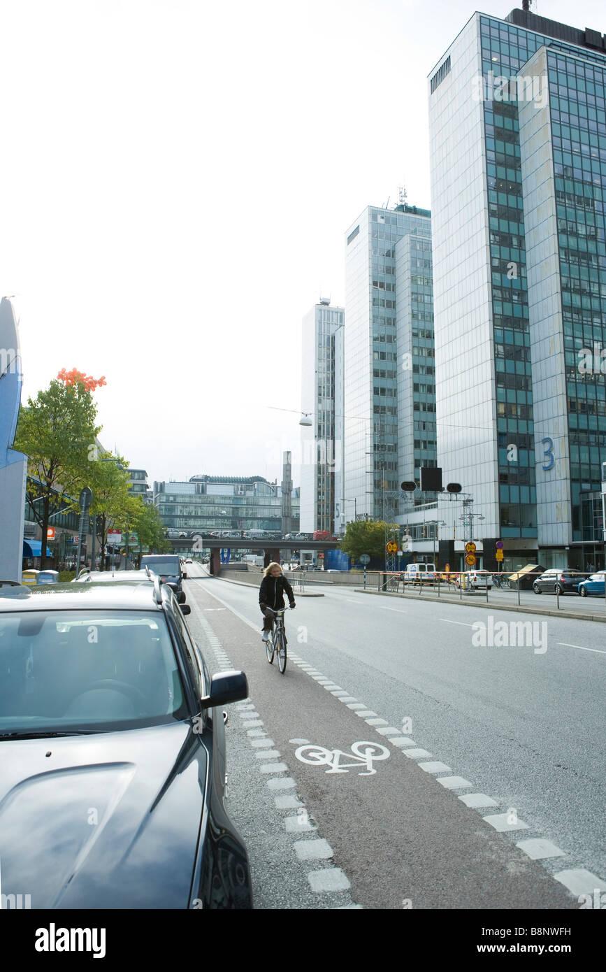 Sweden, Stockholm, bicyclist riding in urban bike lane - Stock Image