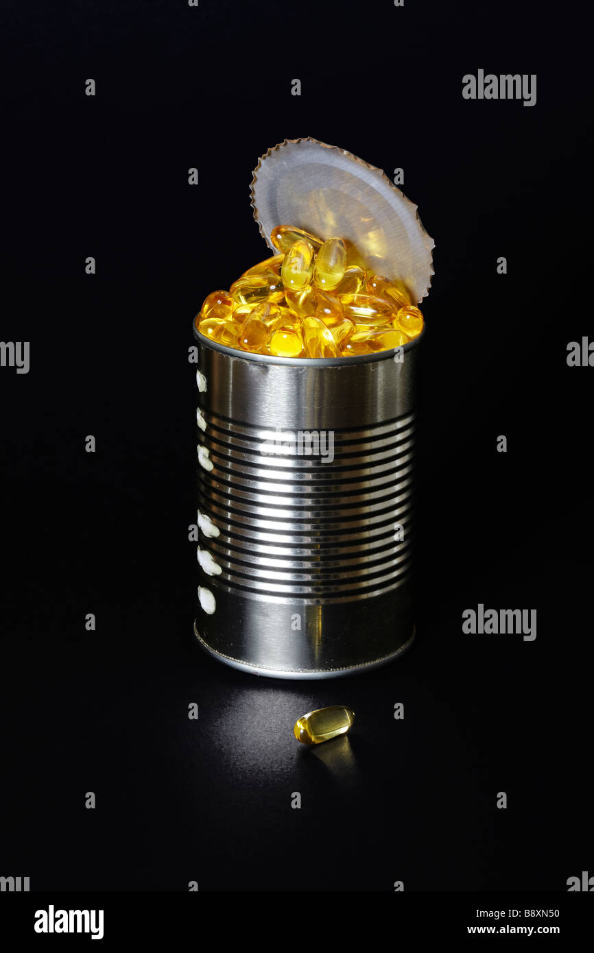 Fish Oil Capsules in an open Tin - Stock Image