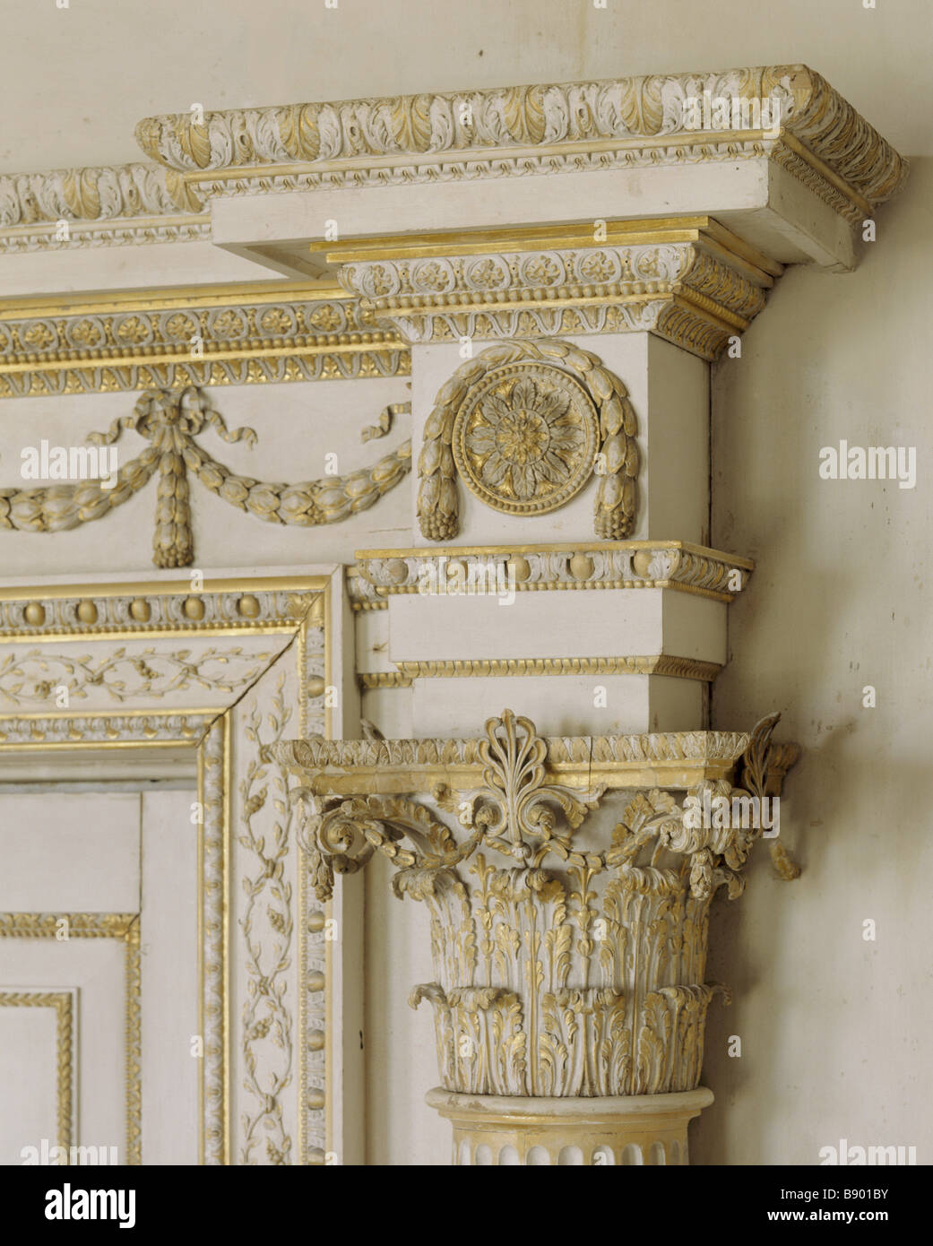Detail of the North Door in The Saloon at Uppark showing ornate carving and gilding - Stock Image