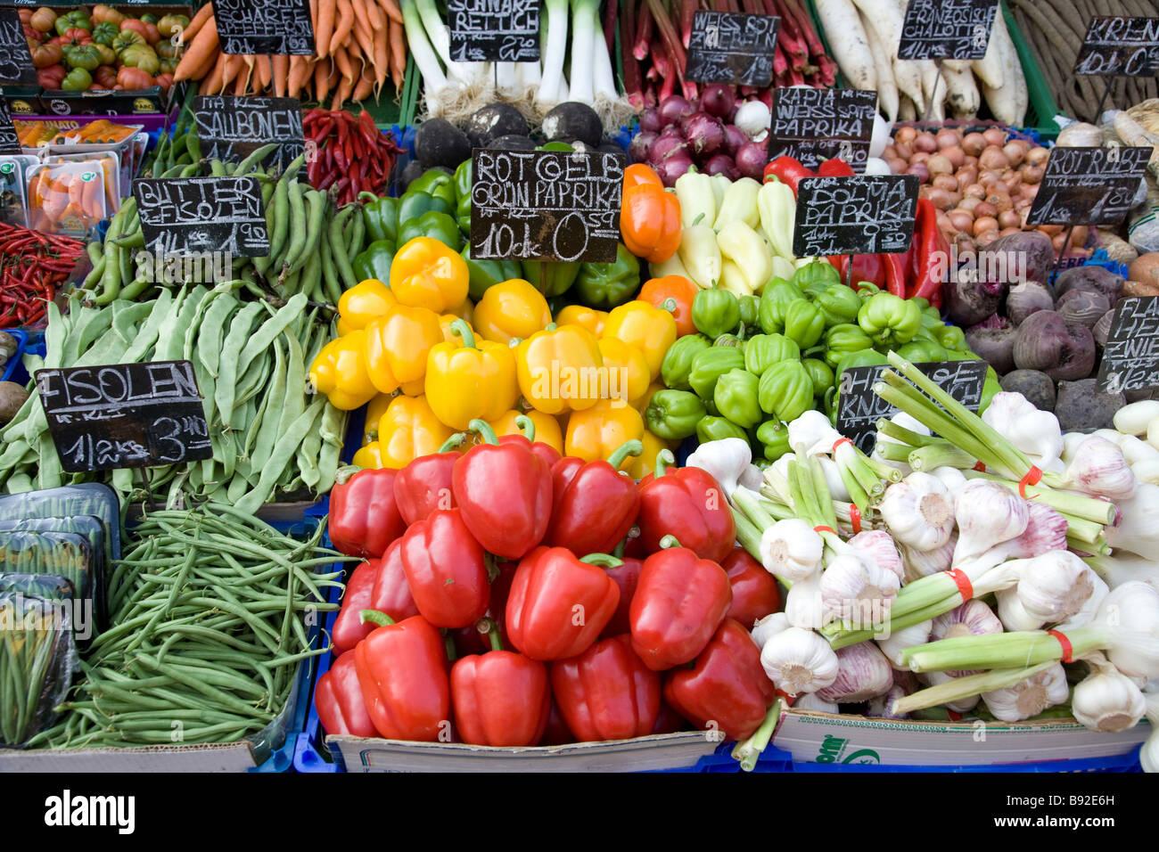 Vegetables displayed on stall at the popular Naschmarkt open air market in Vienna Austria - Stock Image