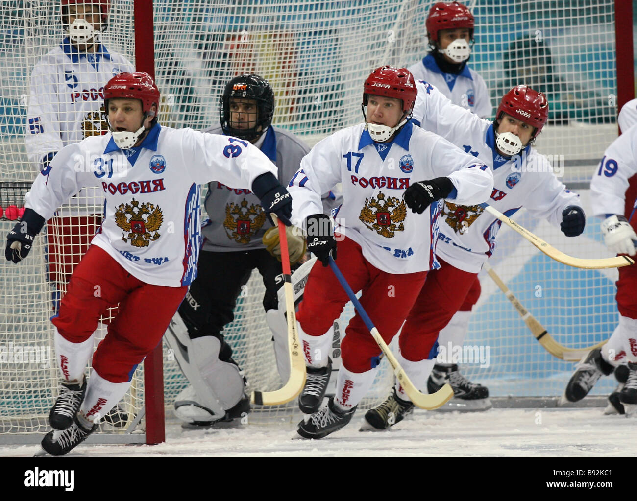 Russian ball hockey players defending their goal - Stock Image