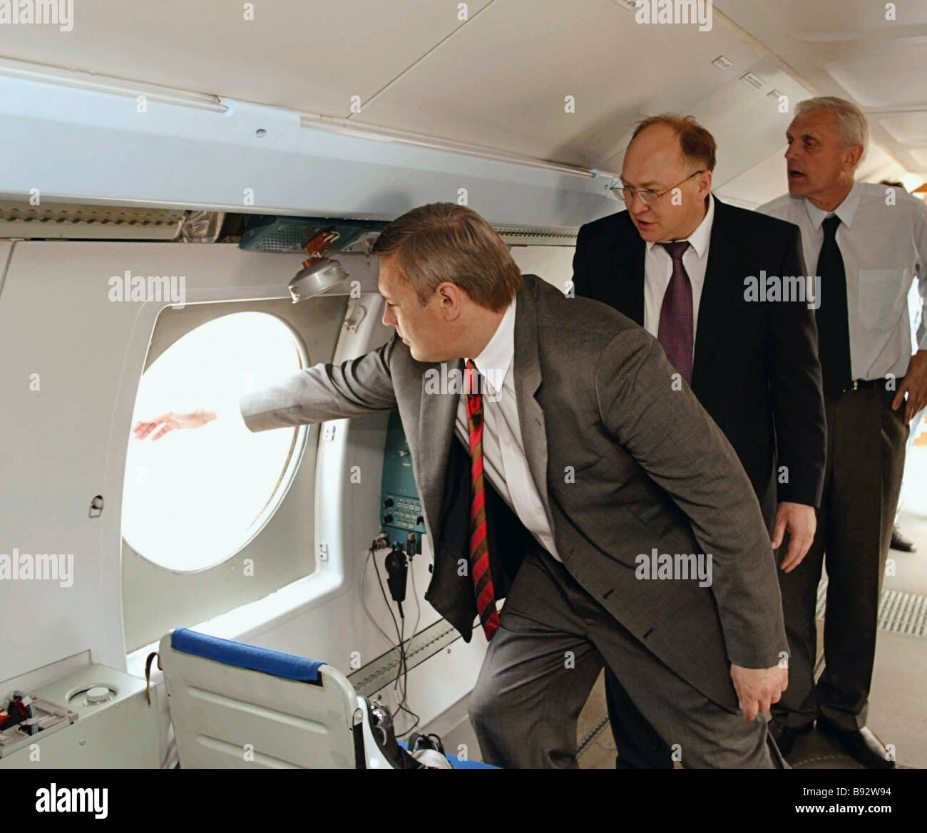 Russian Prime Minister Mikhail Kasyanov on a visit to Siberia Here he is visiting the aircraft factory of the Irkut - Stock Image