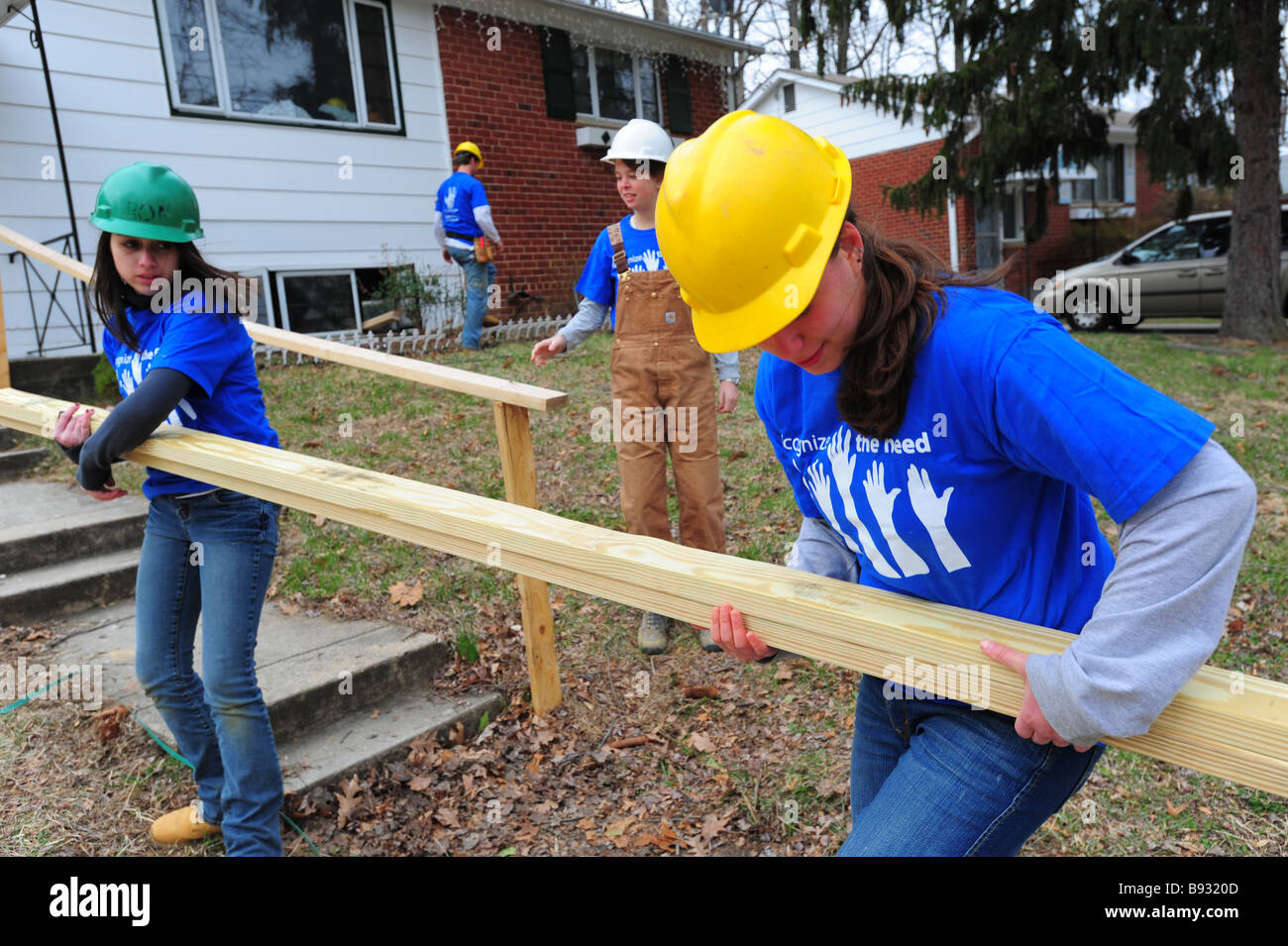 college-volunteers-work-on-renovating-a-house-with-the-non-profit-B9320D.jpg