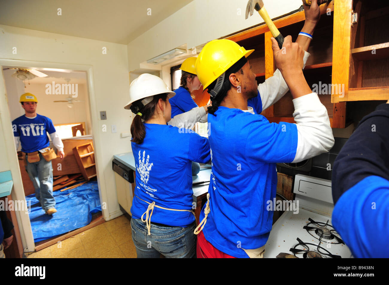 College volunteers work on renovating a house with the non-profit group, Habitat for Humanity-Silver Spring, Maryland Stock Photo