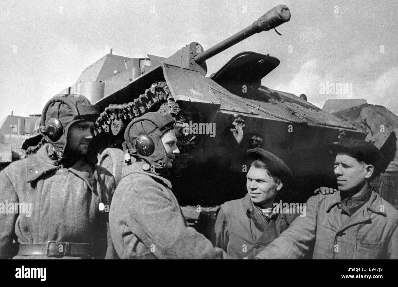 Komsomol members hand self propelled artillery to a crew from the battlefront - Stock Image