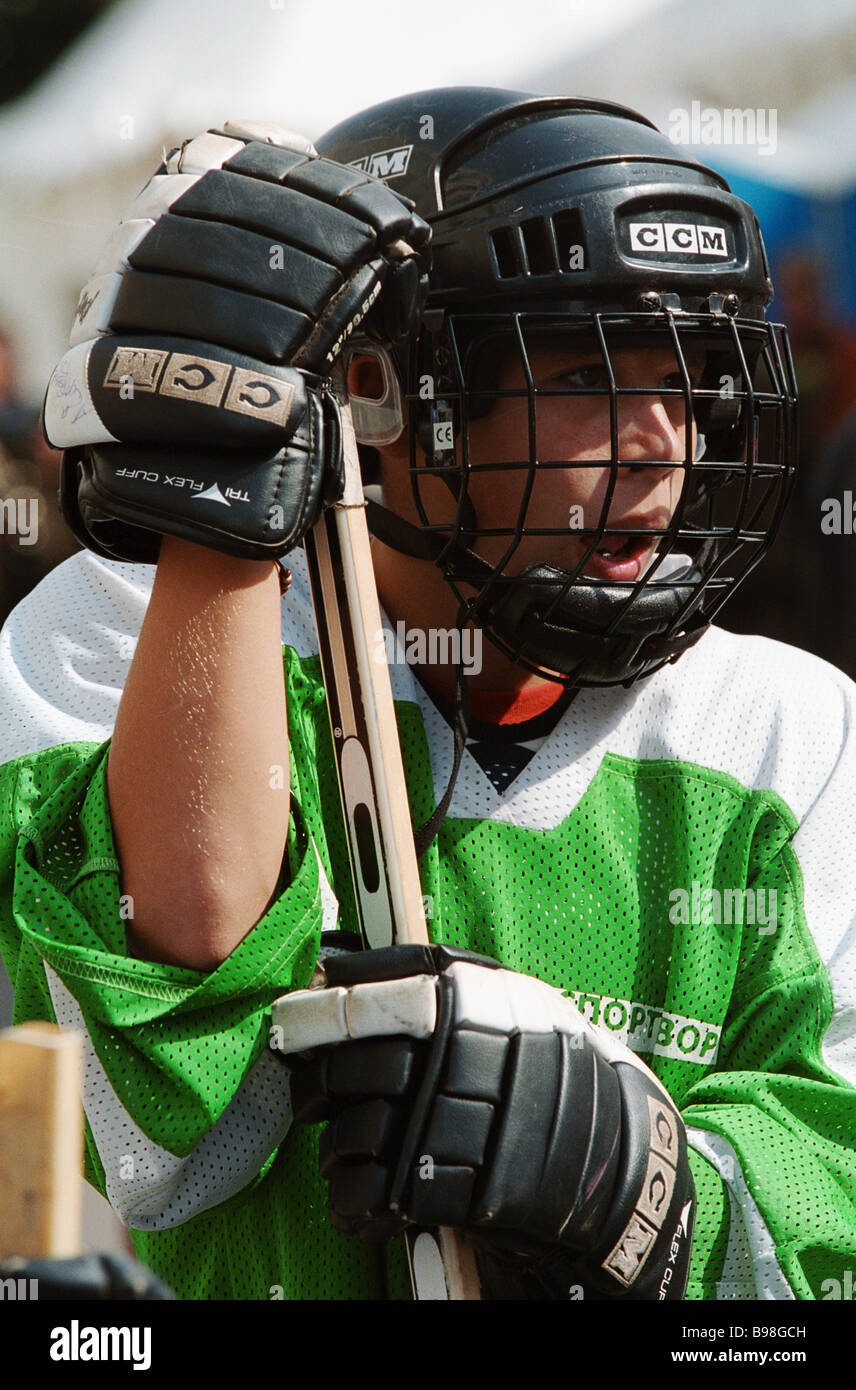 A young hockey player at a City Day holiday - Stock Image