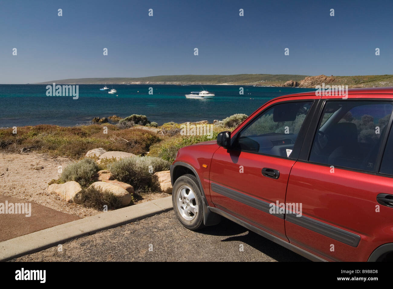 Car parked overlooking the sea in Western Australia's South West - Stock Image
