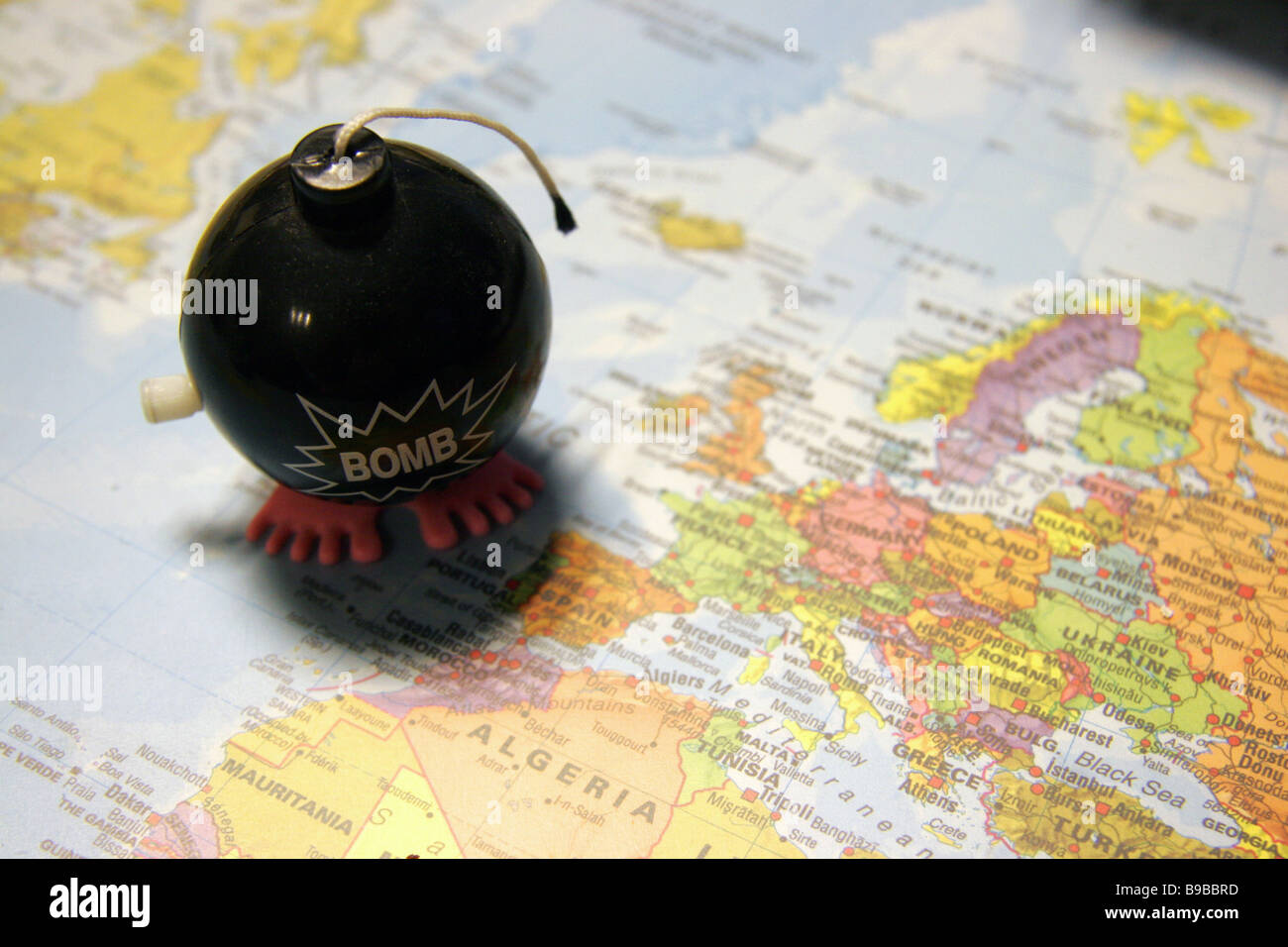 Bomb toy over map of Europe and North Africa - Stock Image