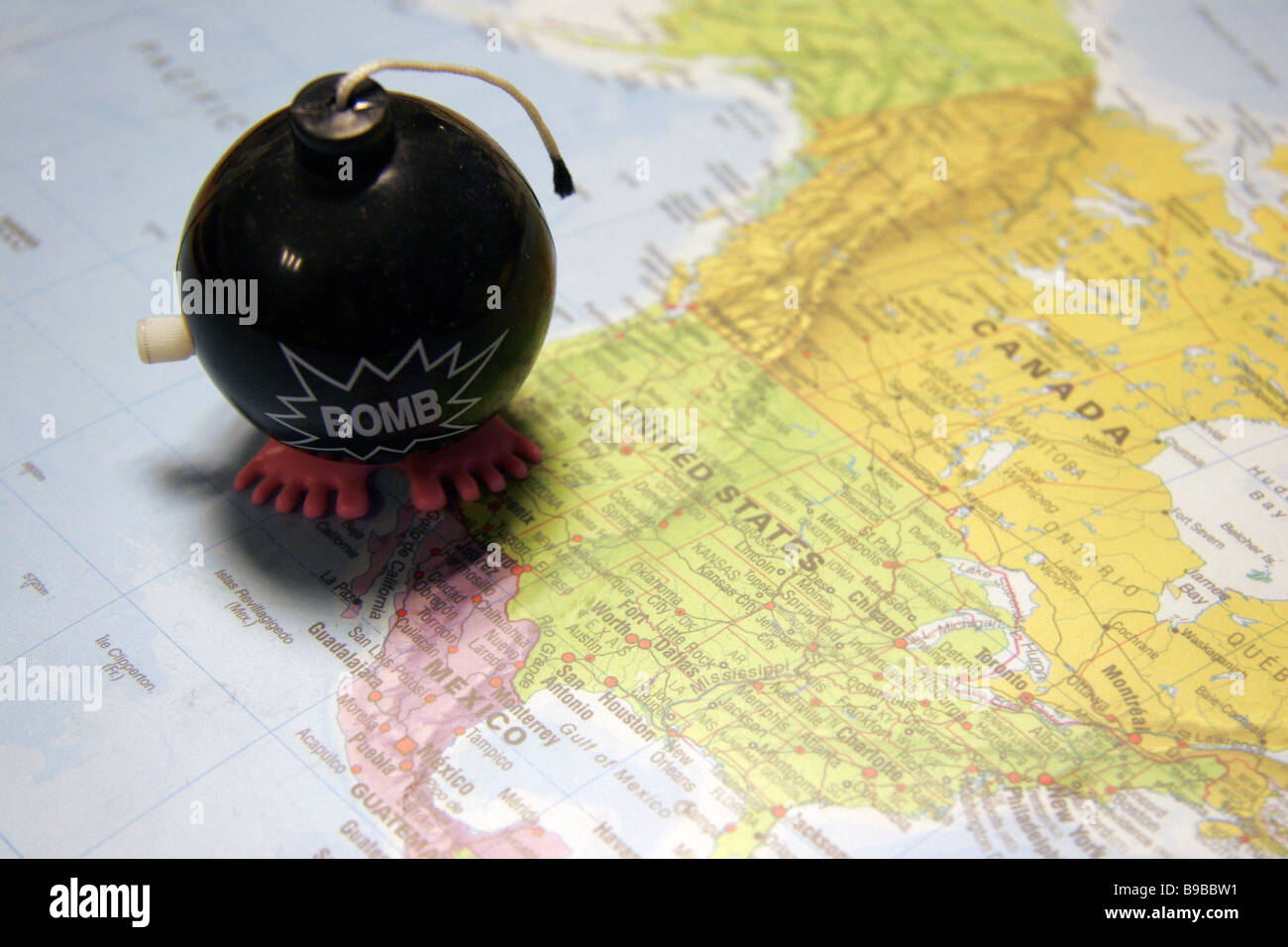 Toy bomb on map of North America - Stock Image