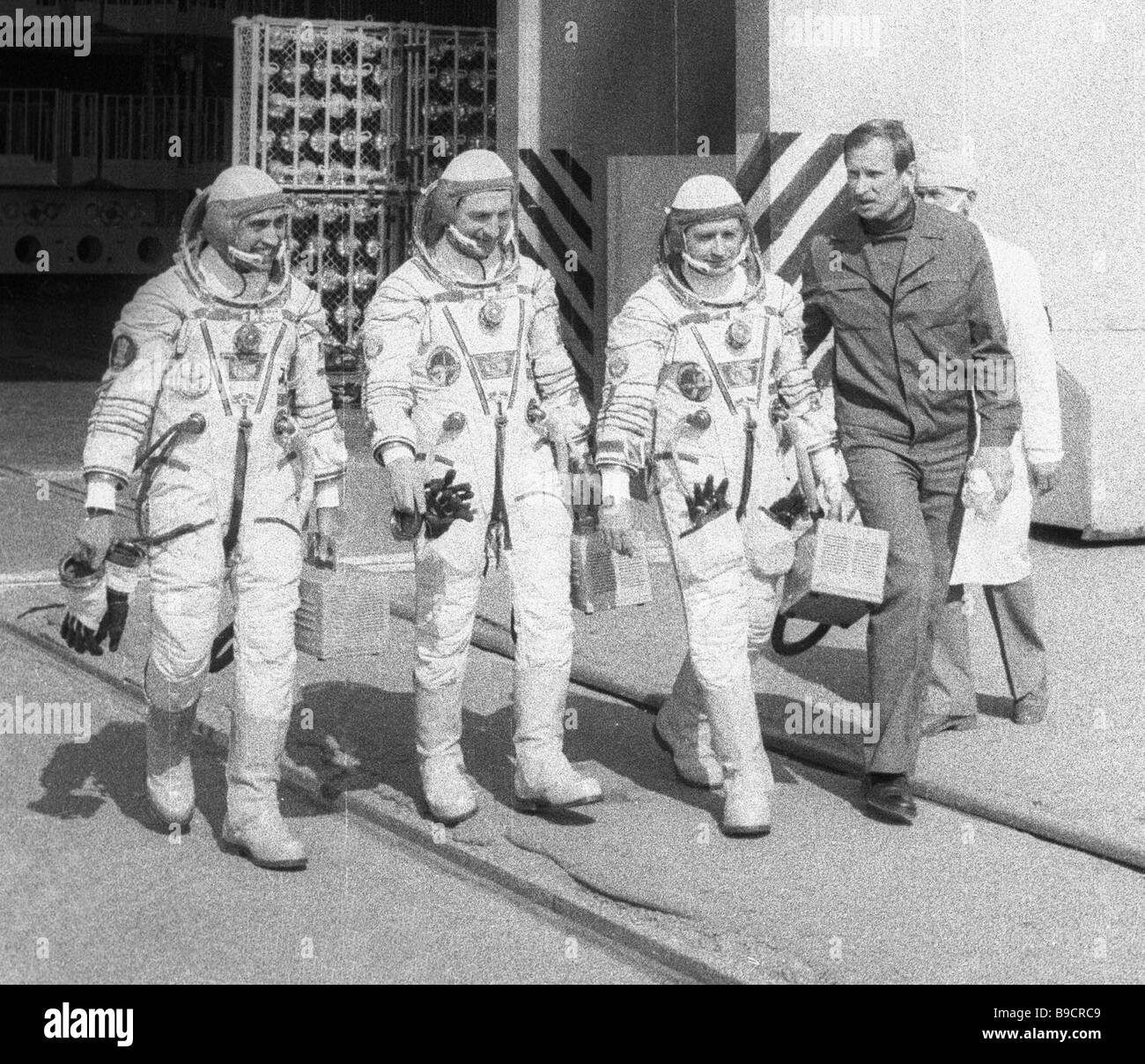 Pilot cosmonauts members of the Soyuz T 11 international space crew before the launch left to right Rakesh Sharma Stock Photo