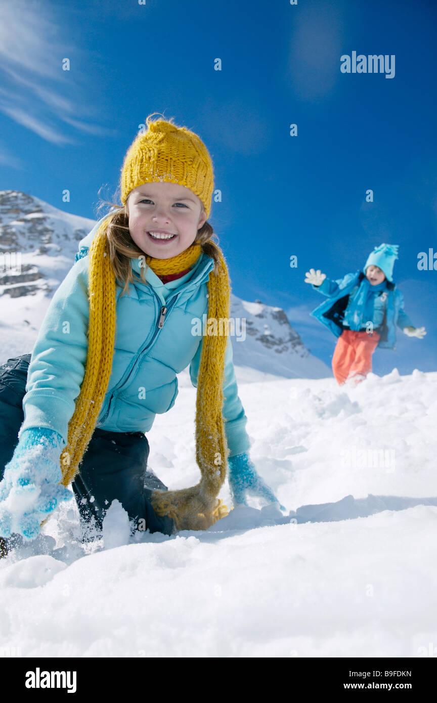 Portrait of girl smiling on snowcovered landscape - Stock Image