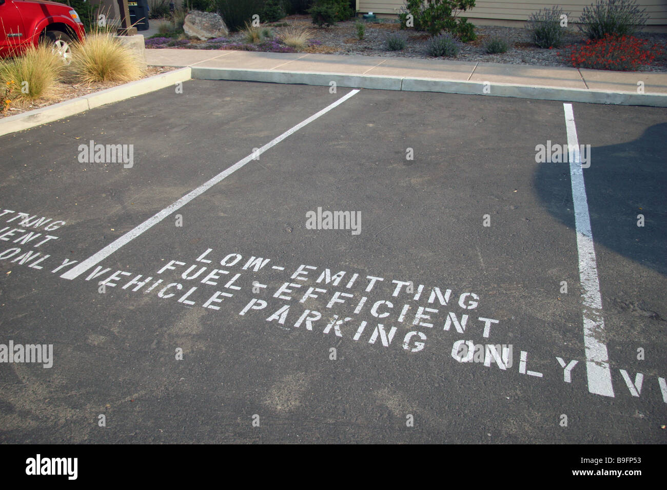 Parking spots designated for Low Emitting Fuel Efficient cars at the GAIA Napa Valley Hotel, American Canyon, California. - Stock Image