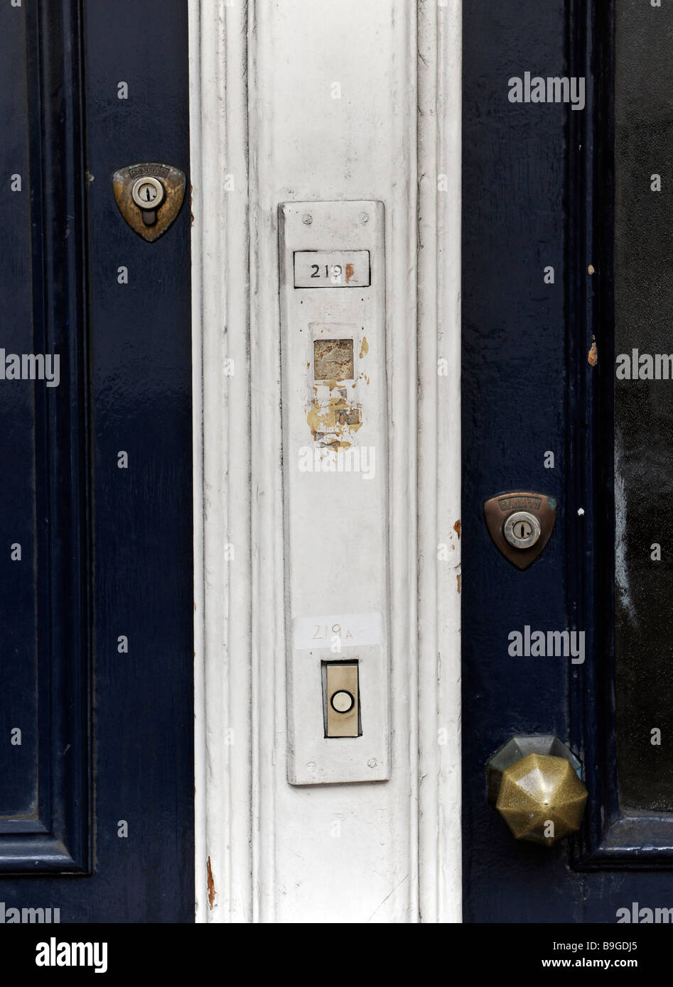 Two front doors to city flats side by side with locks and door bells buzzers & Two front doors to city flats side by side with locks and door ...