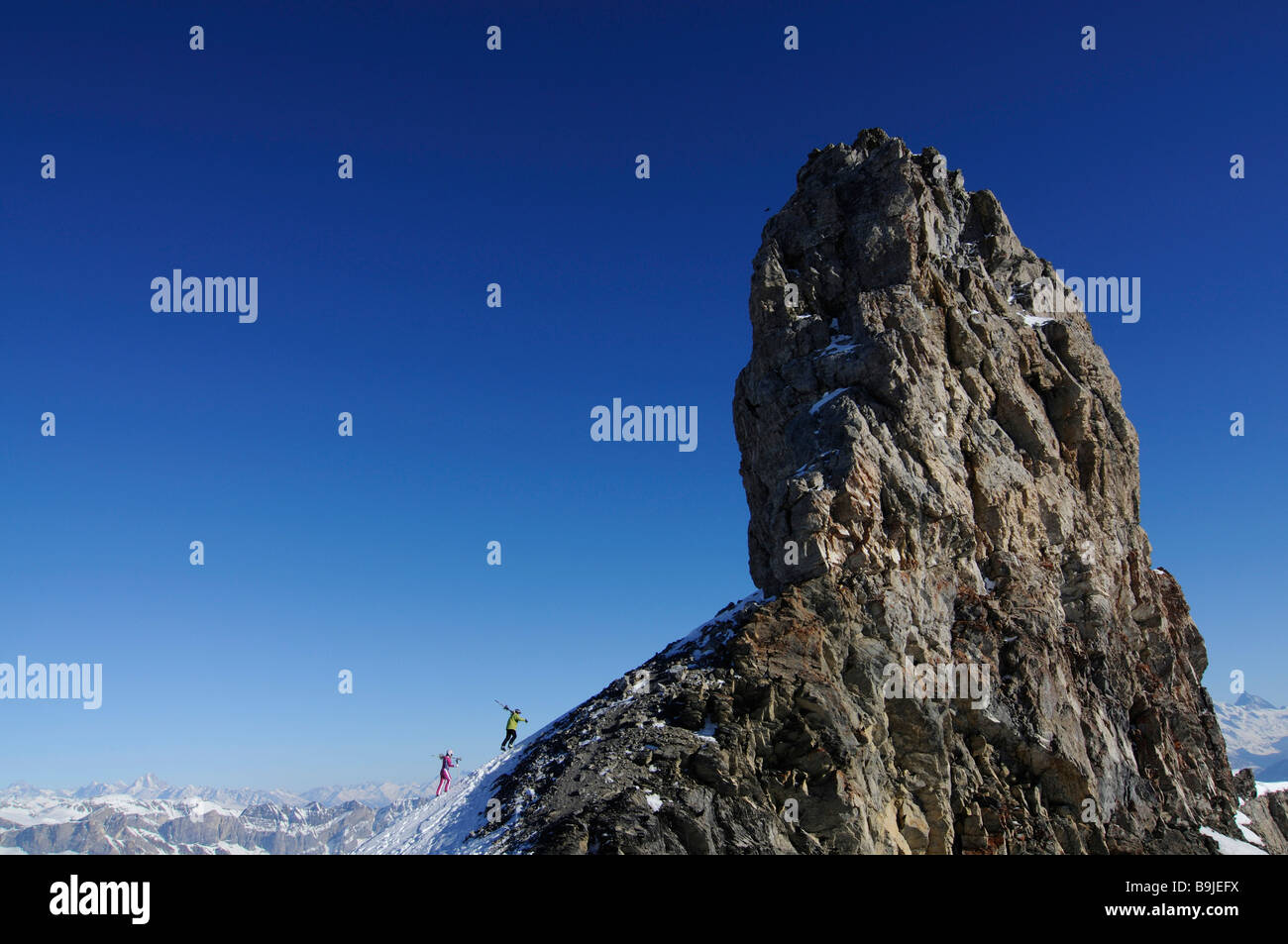 Skiers on Tour Saint Martin, Col du Pillon, skiing region Glacier 3000, Gstaad, Western Alps, Bernese Oberland, - Stock Image