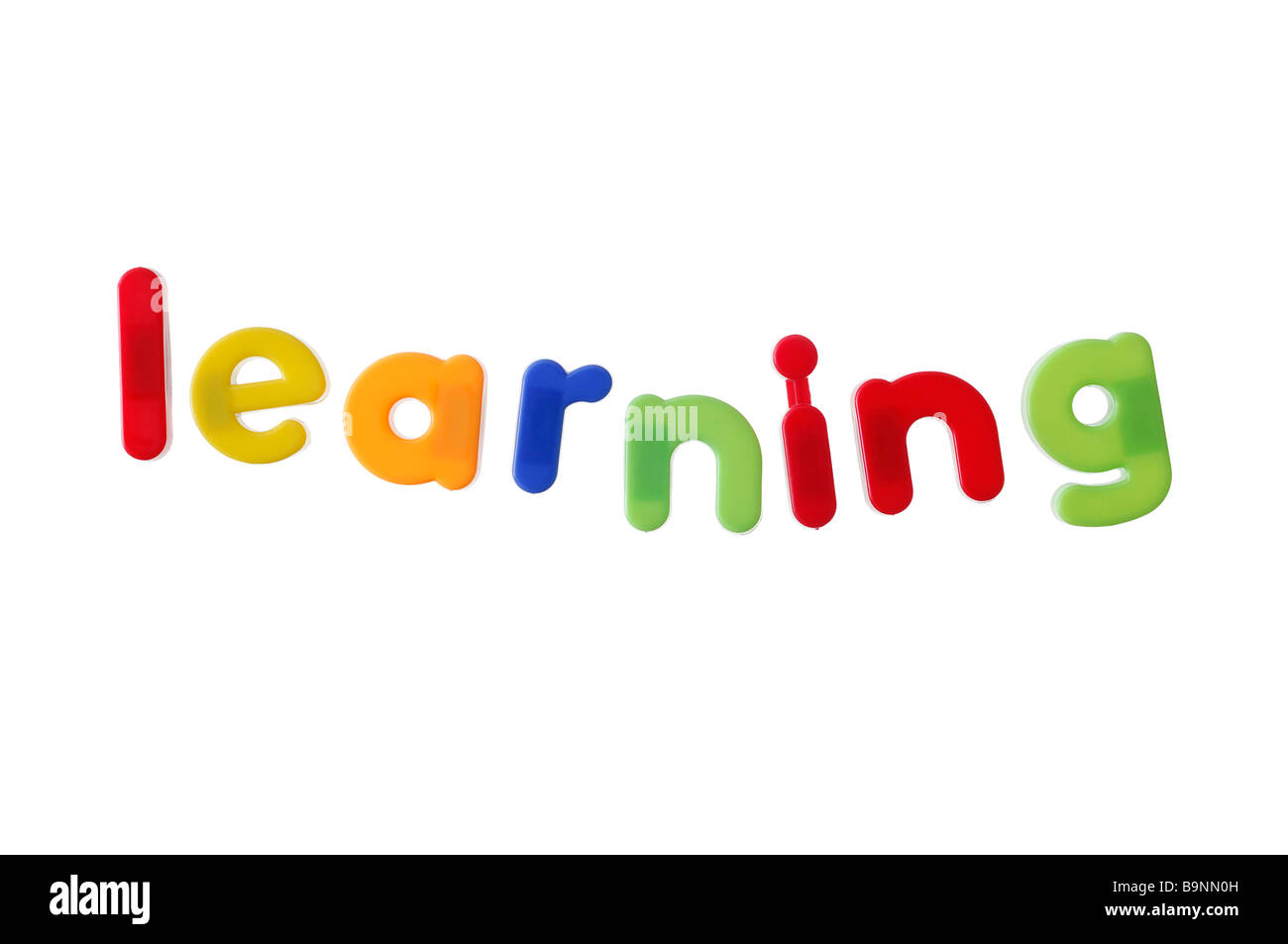 Learning Written with Magnetic Letters - Stock Image