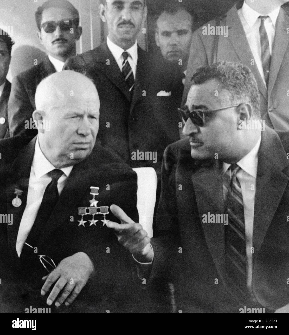 First secretary of the CPSU Central Committee Nikita Khrushchev left talks to the Egyptian President Gamal Abdel Stock Photo